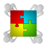 3d people with assembled multicolor puzzle top view Royalty Free Stock Photography