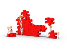 3d people building a puzzle, teamwork Stock Photo