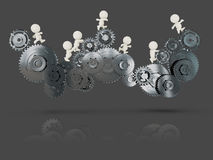 3D people on cogwheels Stock Photography