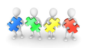 3d people with colored puzzle pieces. In hands. Teamwork concept Stock Photo