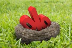 3D percentageteken in nest Stock Foto's