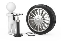 3d Person with Black Hand Air Pump Inflates Car Wheel. 3d Render. 3d Person with Black Hand Air Pump Inflates Car Wheel on a white background. 3d Rendering Stock Photo