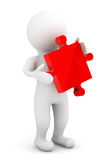 3d person holding a red puzzle. On a white background Stock Photo