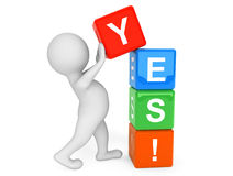 3d person placing Yes Cubes Stock Photo