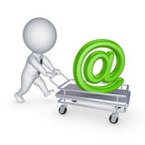 3d person with pushcart and AT symbol. Stock Photography