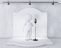 3d Person with Vintage Microphone standing on an stage Royalty Free Stock Photo