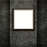 3D picture frame on a grunge brick wall texture Stock Images