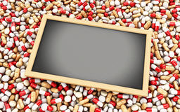 3d Pills, capsules and empty blackboard Royalty Free Stock Photography