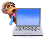 3d Pilot dog behind a laptop pc Royalty Free Stock Photography