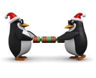 3d pingwiny ciągnie Bożenarodzeniowego krakersa Zdjęcia Royalty Free