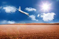3D plane flying over field Stock Images