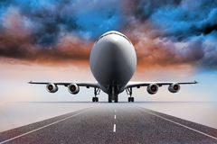 3D plane standing under colorful sky on runway Stock Photography