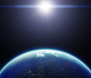 3D Planet Earth with Sun. Elements of this image furnished by NA Stock Photos