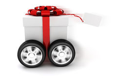 3d present box with red bow on wheels. Isolated on white Stock Photo