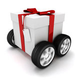 3d present box with red bow on wheels. Isolated on white Royalty Free Stock Image