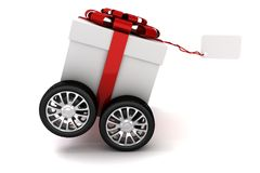 3d present box with red bow on wheels. Isolated on white Stock Photography
