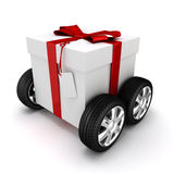 3d present box with red bow on wheels. Isolated on white Royalty Free Stock Photography