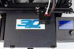 3d print of printer printing symbol logo technology future concept. 3d print of printer printing logo symbol lettering with white blue pla filament modern future royalty free stock photos