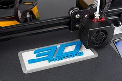 3d print of printer printing symbol logo technology future concept. 3d print of printer printing logo symbol lettering with white blue pla filament modern future royalty free stock photography