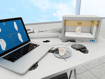 3d printed ear. 3d printing human body. 3d printed body parts with laptop and 3d printer on table, indoors Royalty Free Stock Photo