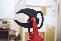 3D printed robot clamp, holder. Plastic manipulator, robotic hand machine tool printed on three dimensional printer. DIY stock image