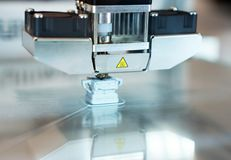 3d printer in action. Head of industrial 3d printer in action stock photos