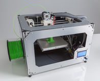 3d printer with bright green filament Stock Image