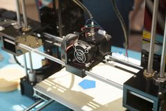 3d printer creating a new plastic object close-up stock image