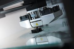 3d printer. Detail of 3d printer printing a plastic piece Stock Images