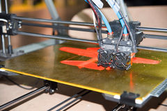 3D Printer - FDM Printing. 3D printing or additive manufacturing (AM) is the use of one of various processes to make a three-dimensional object. This model is stock photo