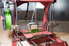 3D Printer - FDM Printing. 3D printing or additive manufacturing (AM) is the use of one of various processes to make a three-dimensional object. This model is royalty free stock photos