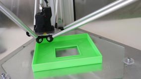 3D printer creating object. 3D printer in high tech laboratory creating object stock video
