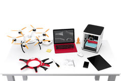 3D printer, laptop, tablet PC and drone on a table. Concept for new technology for DIY Stock Image