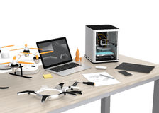 3D printer, laptop, tablet PC and drone on a table. Concept for new technology for DIY Stock Photo