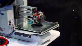 3D printer machine working at modern technology exhibition. stock video footage