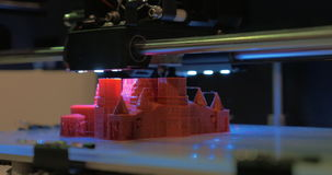 3D printer making model of St Basil Cathedral stock video footage