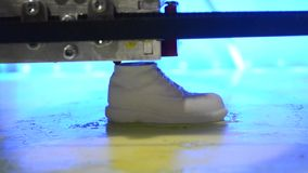 3D printer is a model in the form of shoe stock video