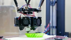 3D printer performs product creation. Modern 3D printing or additive manufacturing and robotic automation technology. Three dimensional printing is a new era stock video