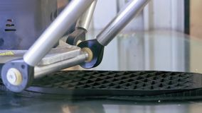 3D printer performs product creation. Modern 3D printing or additive manufacturing and robotic automation technology. Three dimensional printing is a new era stock footage