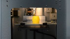 3d printer pouring hot plastic from the nozzle print Model. 3d printer pouring hot plastic from the nozzle print isolated objects or model yellow. Modern 3D