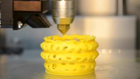3d printer pouring hot plastic from the nozzle print Model stock footage