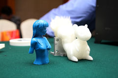 3D Printer - Print model. A girl and a squirrel.The future of science and technology,The application in teaching and life Stock Image