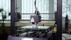 3D printer printing a gray screw. Detail shots of a 3d printer printing a big gray screw stock video footage