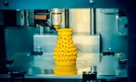 3d printer printing objects yellow form closeup. stock images