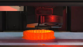 3D printer printing red detail stock video footage