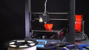 3D printer printing a red vase, Black background. A 3d printer printing a red vase  in front of black background stock footage