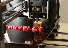 3D printer printing words with red plastic Stock Photos