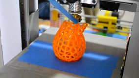 3D printer prints the figure orange