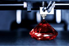 3D printer prints a gem, Ruby with transparent filament royalty free stock photography