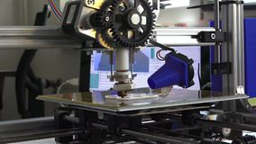 3d printer prints parts. For homemade construction, side view stock footage